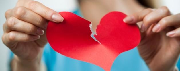 woman-tearing-heart